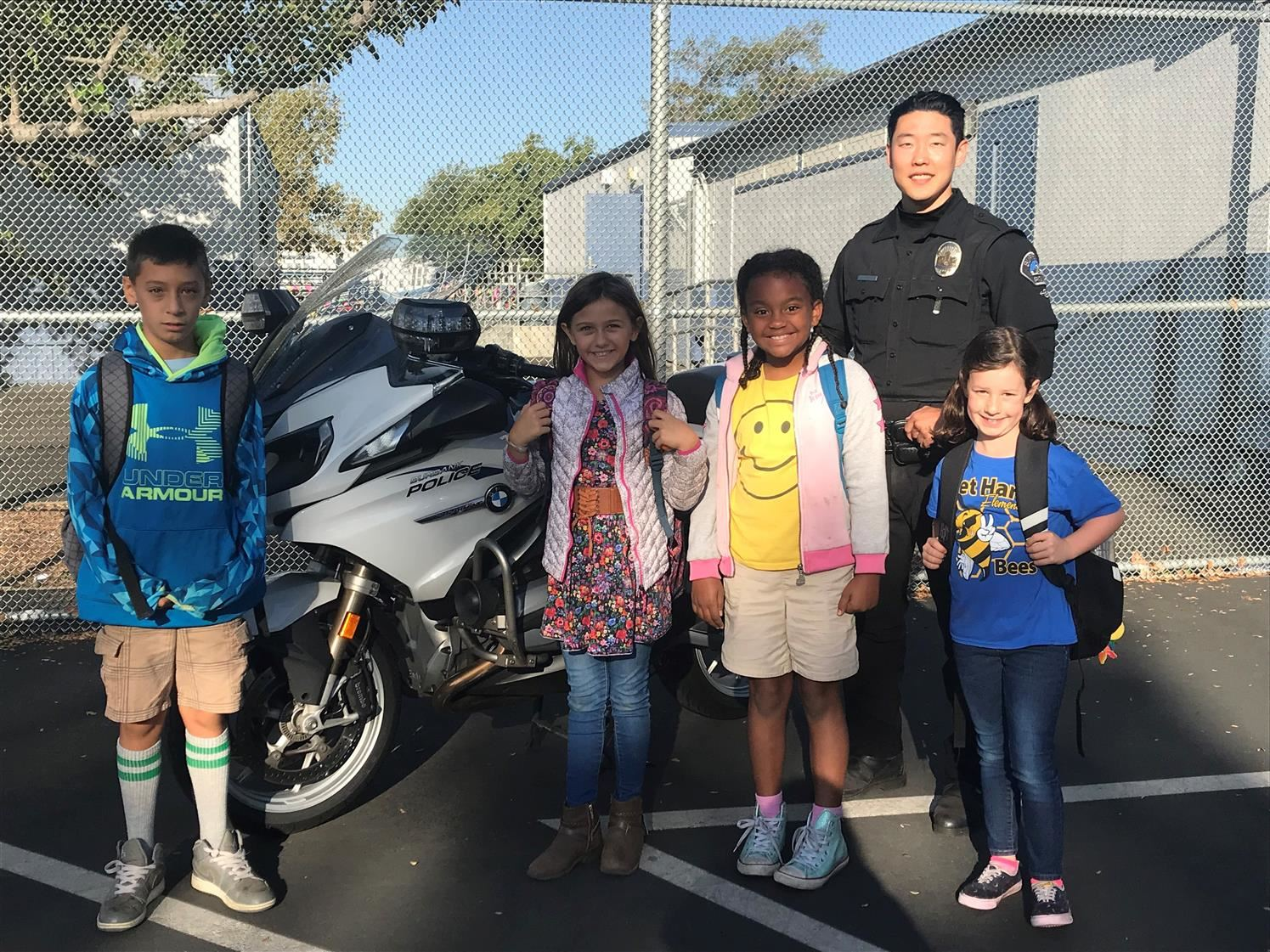 Burbank police officer with students from Bret Harte Elementary.