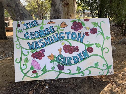 Photo of the new George Washington Garden sign at the entrance to the garden